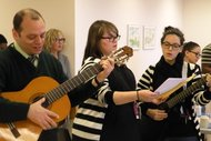 Staff members at the Hebrew Home singing at memorial service. From left, Larry Applewhite, Liisa Murray and Olivia Cohen.