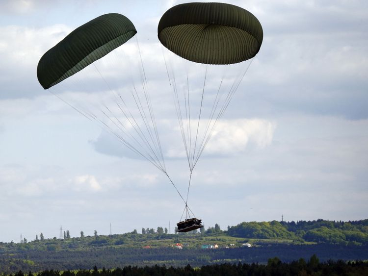 A Humvee is dropped as part of a training exercise