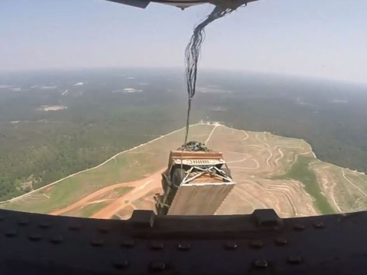 A still from library footage of Humvees being dropped