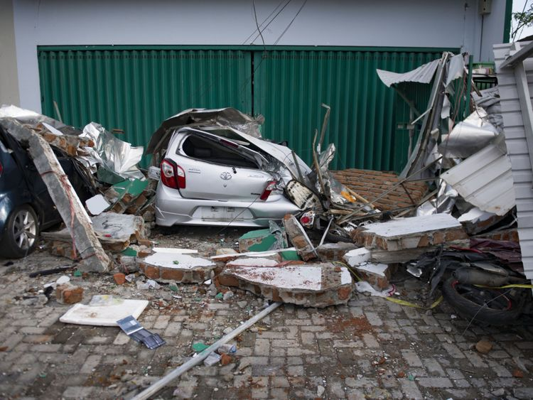 A damaged car following the tsunami and earthquake in Palu