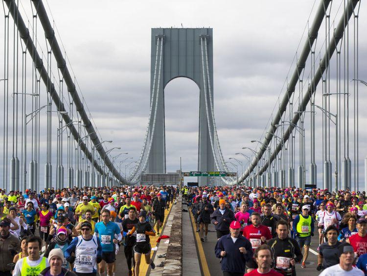 Runners cross the Verrazano-Narrows Bridge during the New York City Marathon in New York, November 3, 2013