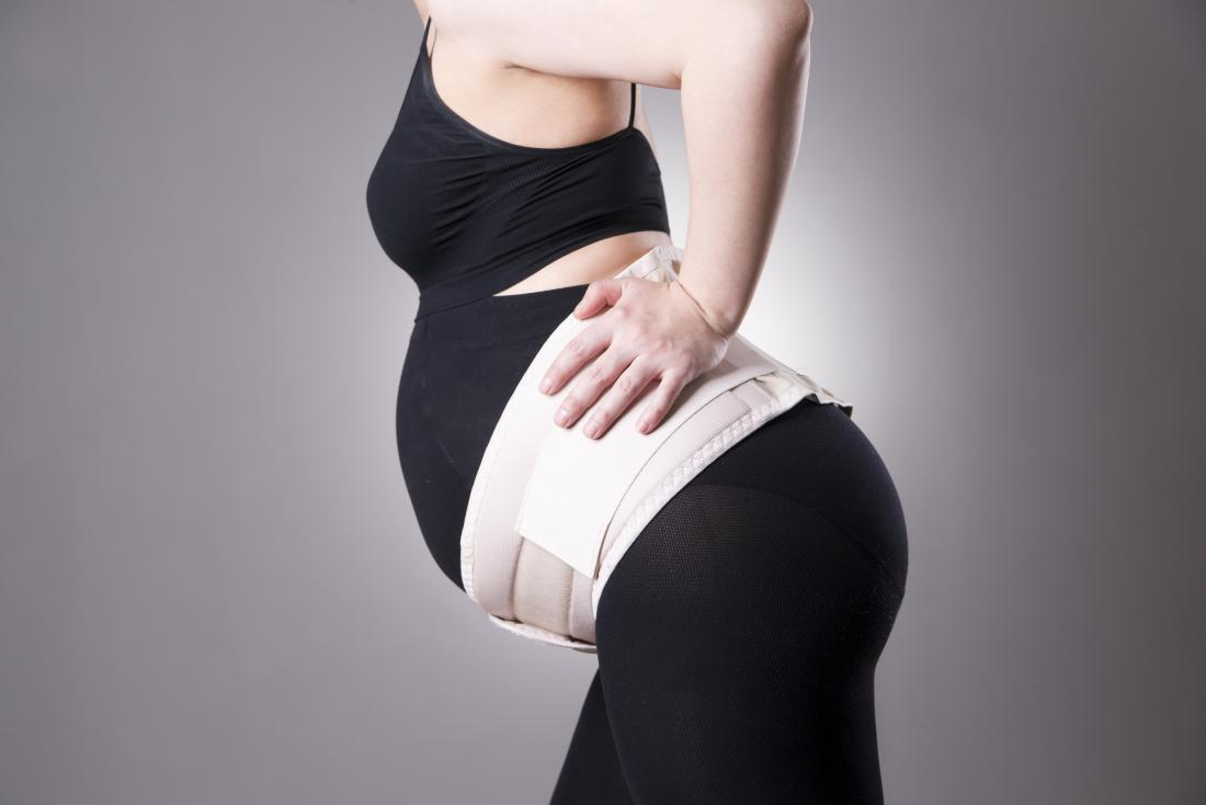 Belly belt on a pregnant woman