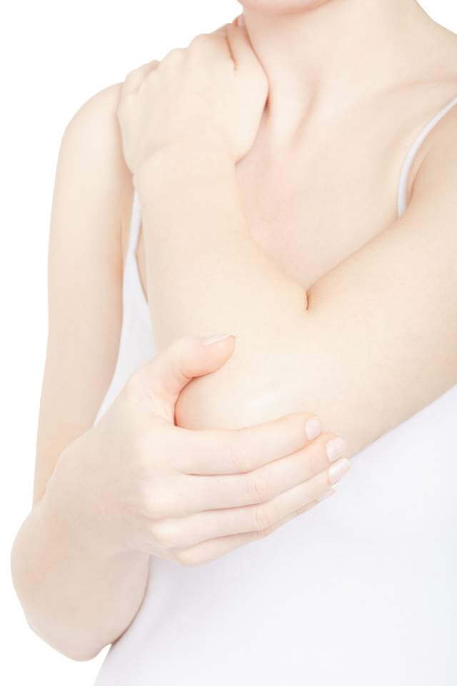 woman-holding-elbow-and-shoulder-in-pain-isolated