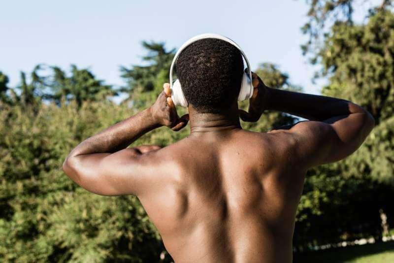 athletic-black-man-listening-to-music