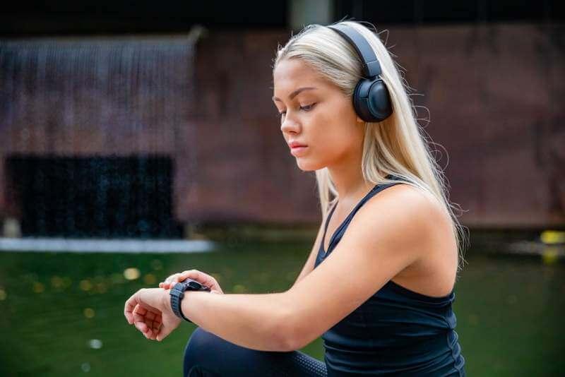 sporty-female-runner-listening-music