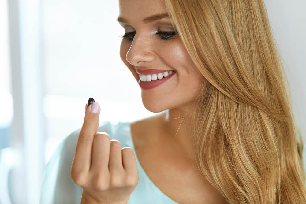 Zenflore-woman-happy-mood-taking-probiotic