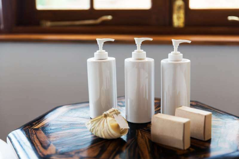 bottles-with-liquid-soap-or-lotion-at-spa