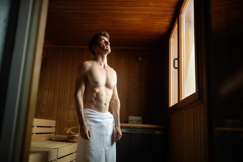 smiling-man-having-a-sauna-bath-in-a-steam-room