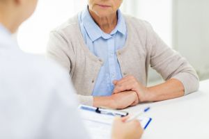 Senior woman talking to a healthcare professional