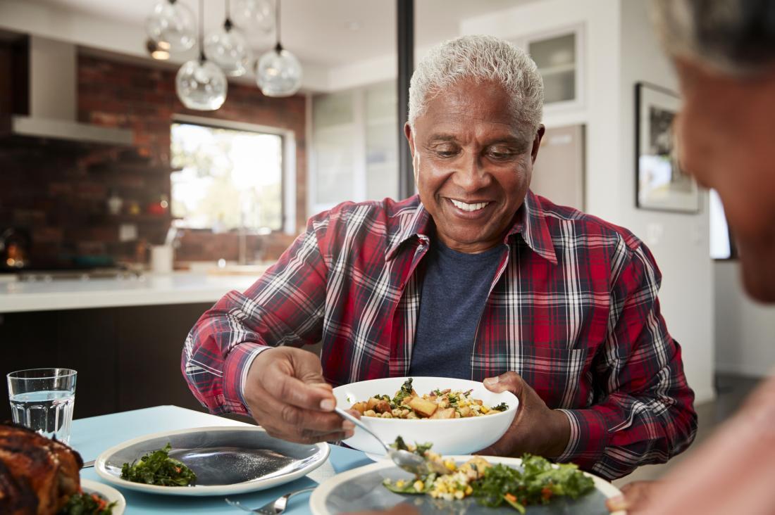 senior man eating