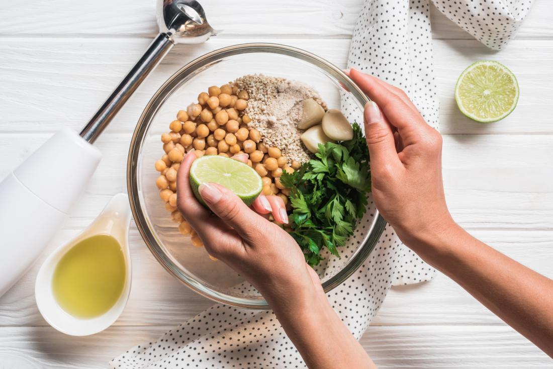 woman making hummus