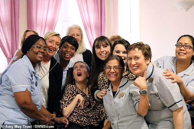 For the pastthree years, Ms Shead has lived at the Marillac Care centre in Brentwood, Essex. She is pictured with the staff during her send off. She also spent two years in London hospitals