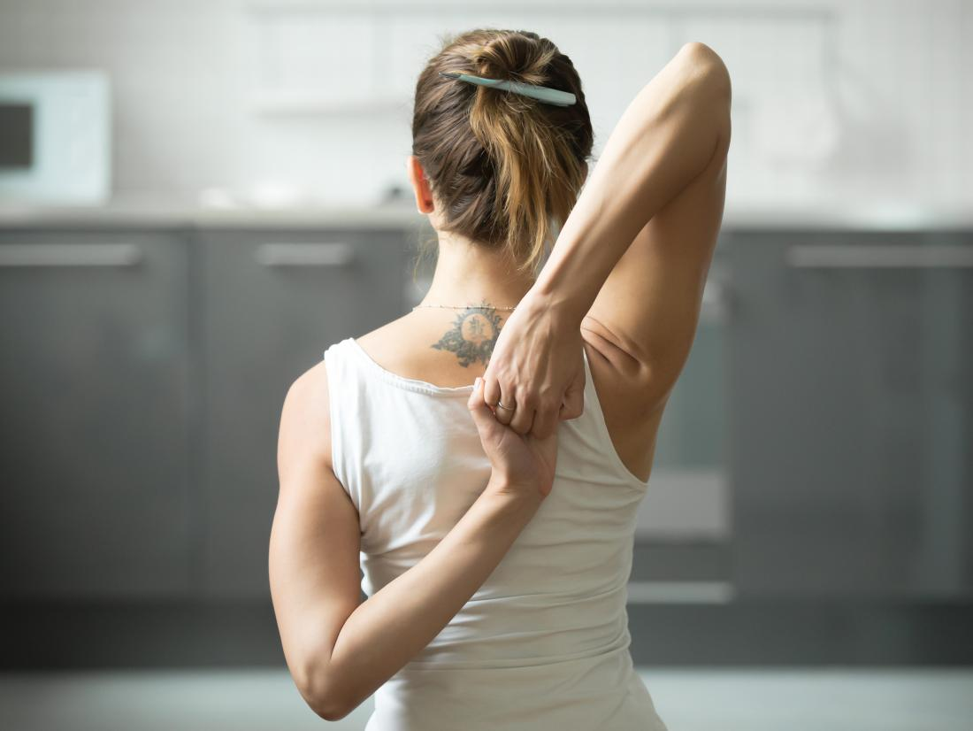 Cow face yoga stretch for arm and shoulder exercise