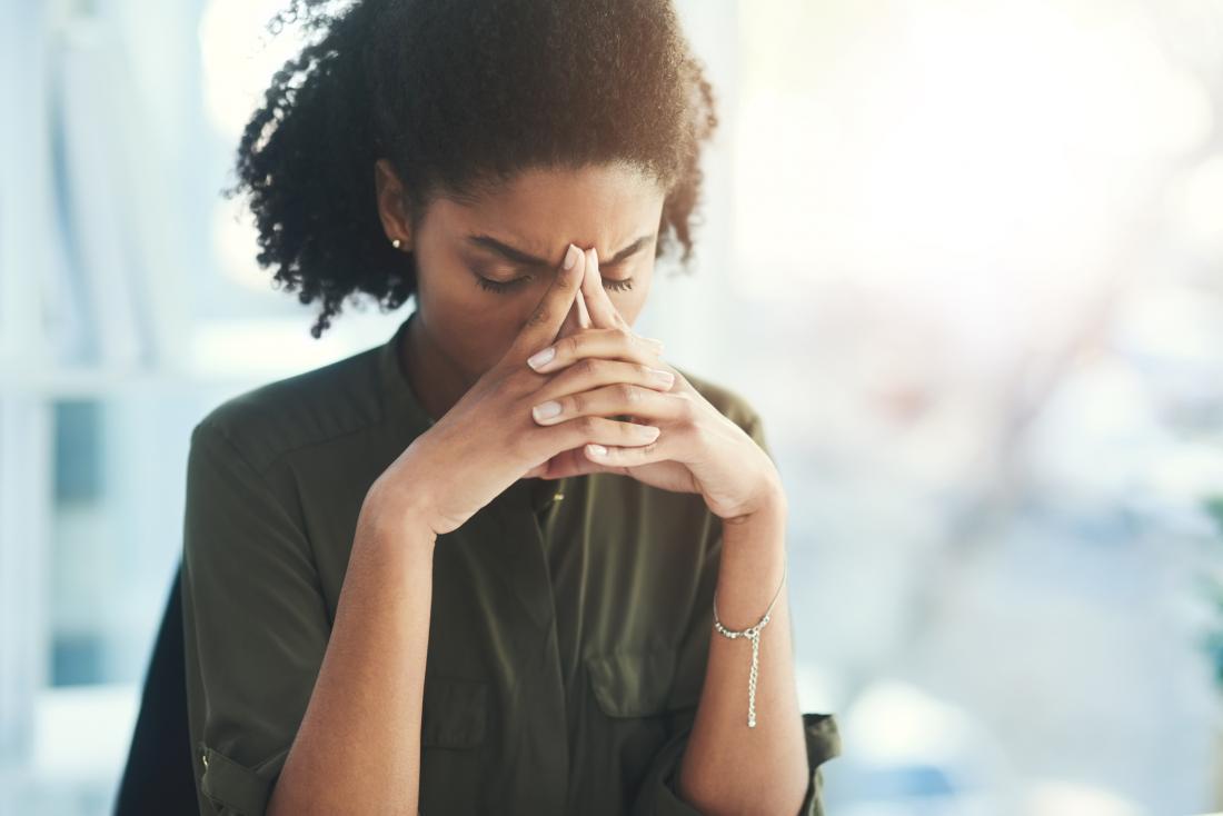 Stressed woman sitting alone