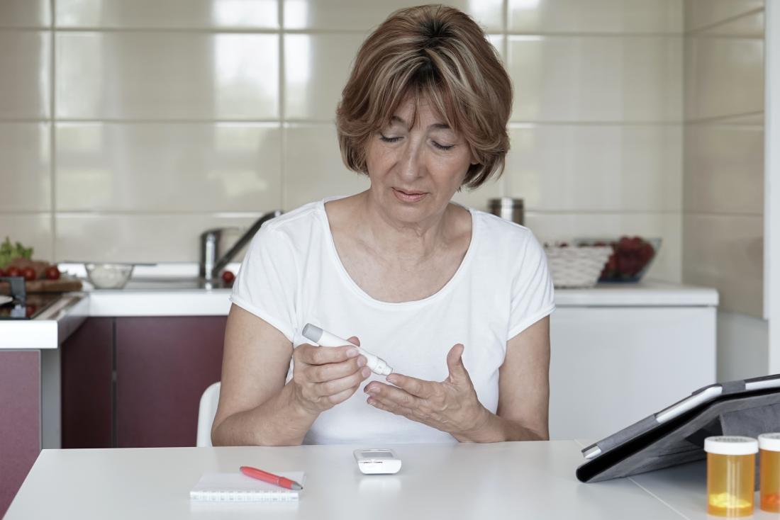 senior lady recording her glucose levels