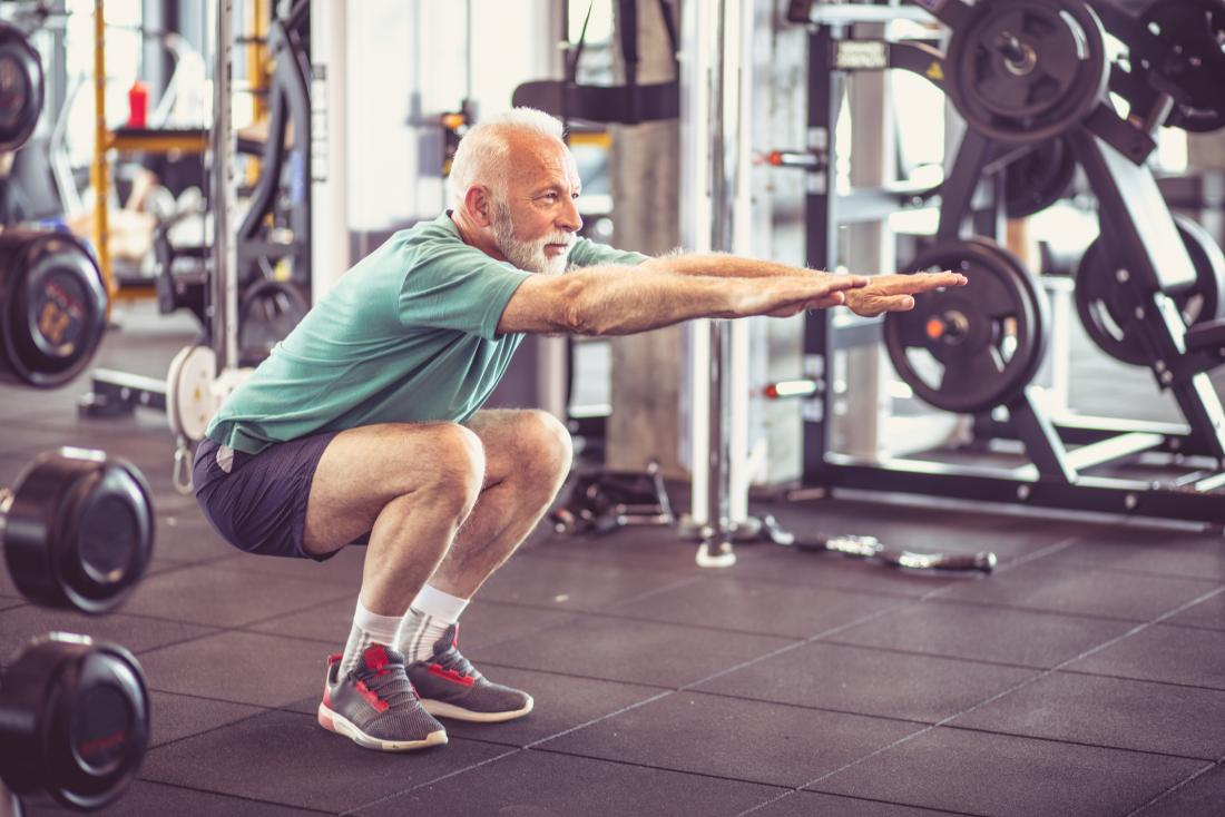 senior man doing squats