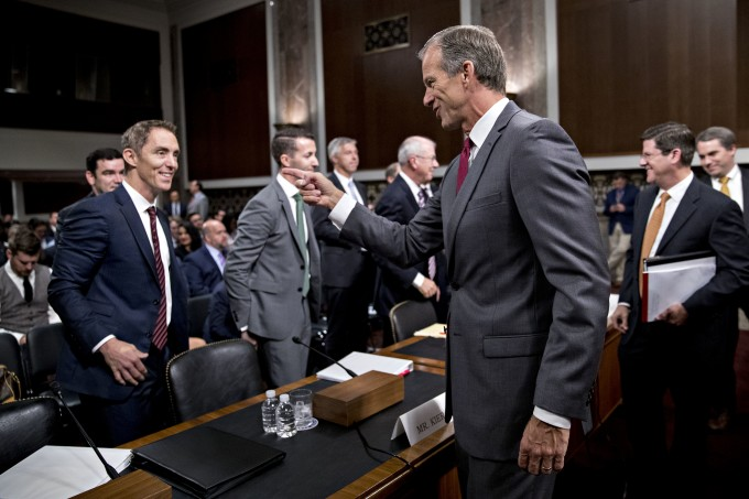 Senator John Thune, a Republican from South Dakota and chairman of the Senate Commerce Committee, right, greets Keith Enright, chief privacy officer with Google Inc., left, during a hearing on consumer data privacy in Washington, D.C., U.S., on Wednesday, Sept. 26, 2018. Facing growing pressure to protect their customers' privacy, some of the biggest technology companies told Congress that they favor new federal consumer safeguards but diverged on some of the details.