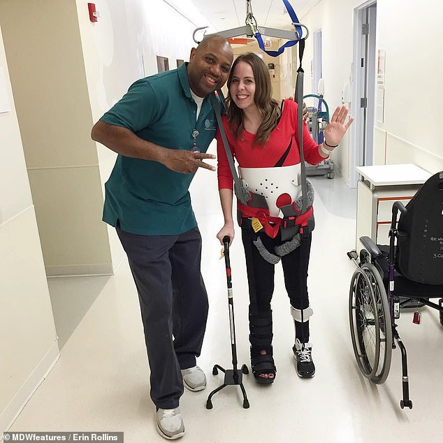 Mrs Rollins, pictured with a doctor learning how to walk again using a stick and harness hanging from the ceiling, suffered an incomplete spinal cord injury and two burst fractures which sent shards of bone into her spinal canal, resulting in paralysis from the waist down