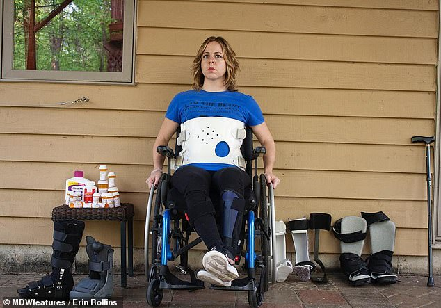 Mrs Rollinswas driving in November 2014 when a she was involved in a collision that paramedics said she was lucky to survive. She had to re-learn to walk. Pictured in a wheelchair while wearing a brace to support her back