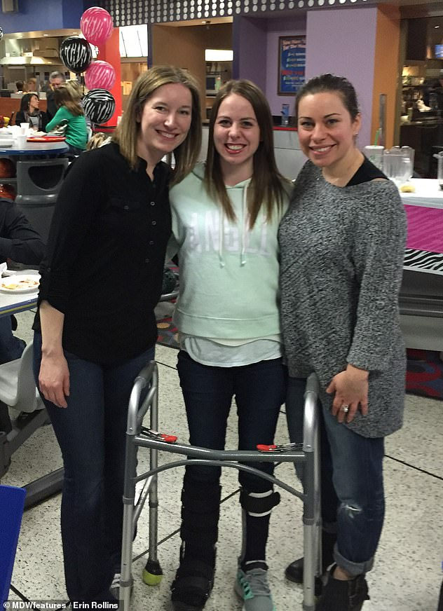 Mrs Rollins began physiotherapy on December 6 and by December 18 she was able to walk with a walker and a harness for support. Pictured with friends after weeks of physiotherapy