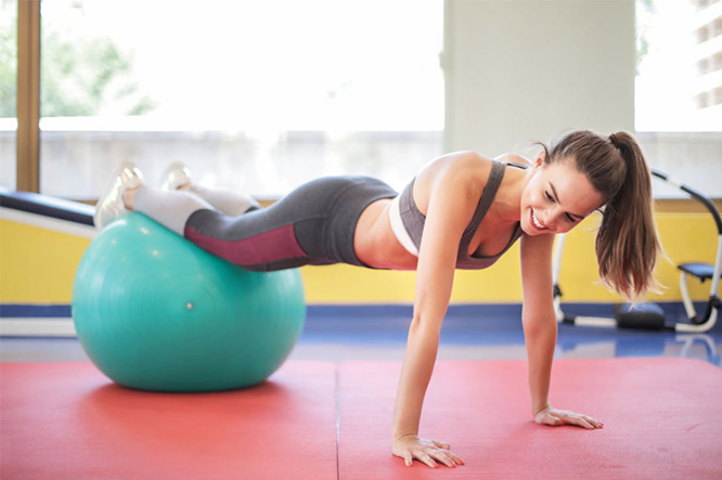 woman exercising during her period