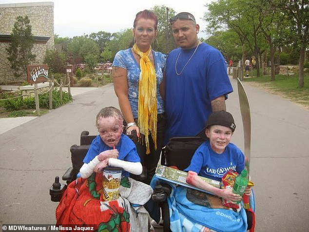 Mrs Jaquez is pictured with her children's father and their sons Marky (right) andCarlos Xavier Tharp-Jacquez (left). Carlos died fromheart failure related to the disorder aged just 14 in November 2013. MrsJaquez began caring for Marky full time in November last year