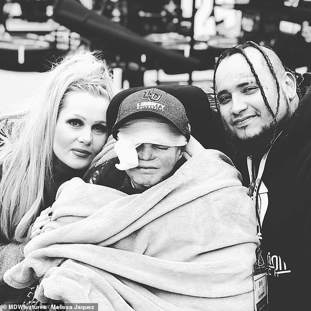 Pictured with his parents, Marky cannot walk and relies on a specially-adapted wheelchair