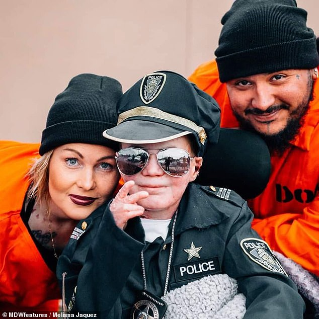 Marky is pictured dressing up as cops and robbers with his parents. His pain and limited movement means he spends most of time indoors, watching movies and listening to music