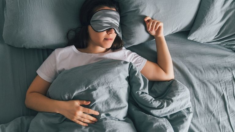 how to stop ageing - woman sleeping - anti ageing