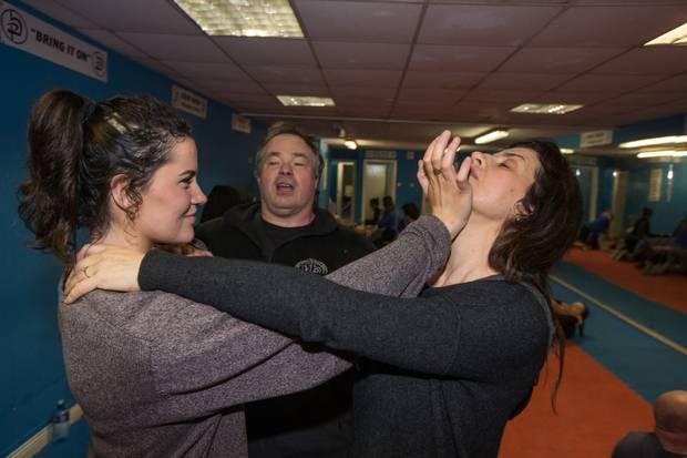 Denise Deegan and her daughter Aimee at Krav Maga Irelandwith their instructor Patrick Cumiskey. Photo: Mark Condren