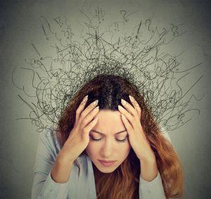 Woman grasping head