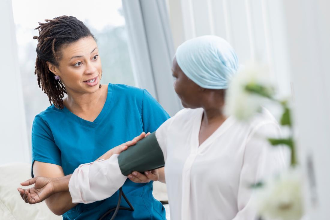 nurse taking patient's blood pressure