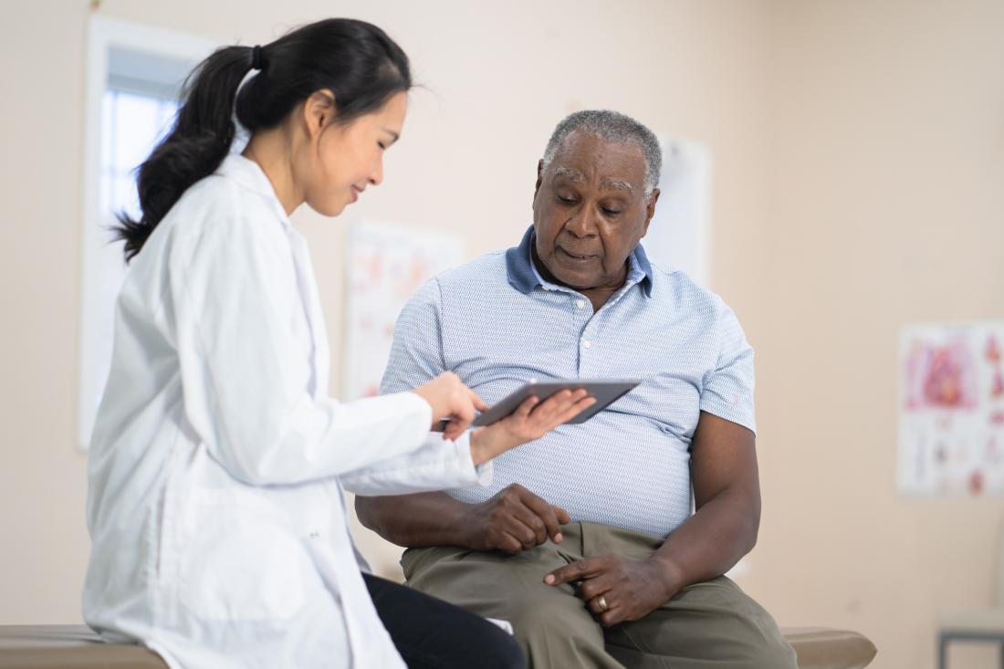 doctor talking to senior patient