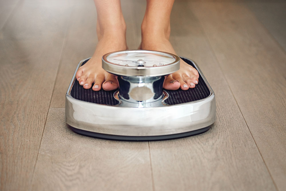 woman-on-scales-week-11-transformation.jpg