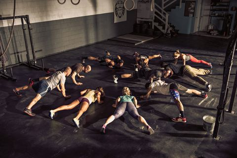Fitness class training together in gym