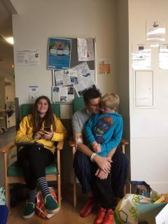 Adam Martin with two of his three children while in the hospital.