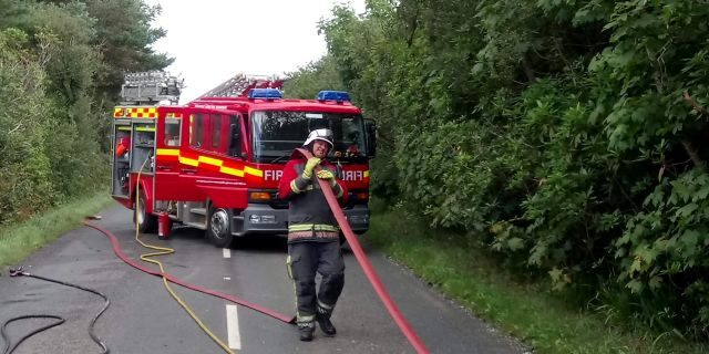 Adam Martin doing his job as a firefighter.