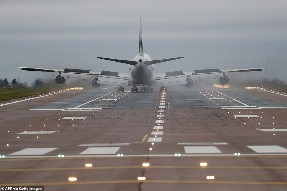 The Wuhan evacuation flight, which left the deserted Chinese city at 9.45am local time (1.45am GMT), is pictured on the runway at RAF Brize Norton