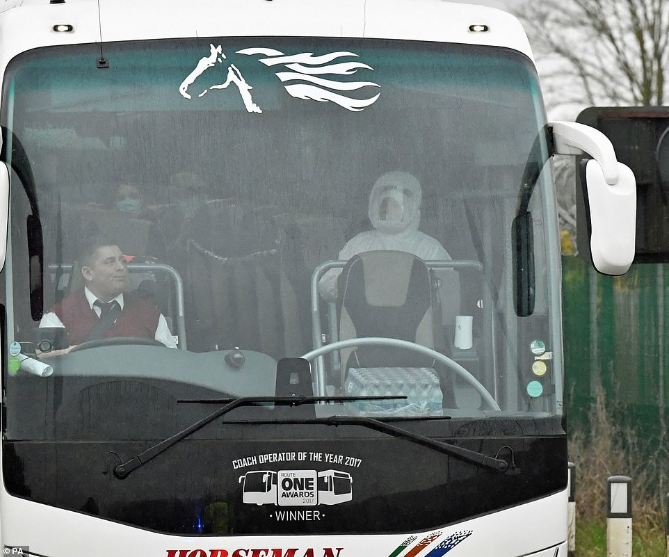 Another bus driver is seen without protective equipment