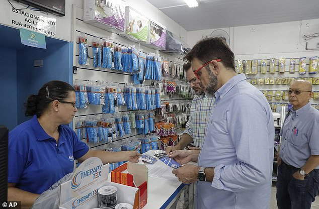 He adds that he believe the coronavius outbreak too will run its course but, in the meantime, he recommends staying vigilant. Pictured: Customers buy masks at a medical supply store inSao Paulo, Brazil, February 26