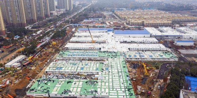 The Huoshenshan temporary field hospital under construction is seen as it nears completion in Wuhan in central China's Hubei Province, Sunday, Feb. 2, 2020. (Chinatopix via AP)