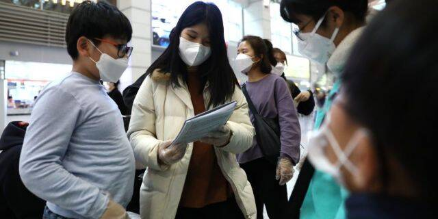 South Korean teenagers wearing masks at the Incheon International Airport on January 27, 2020, in Incheon, South Korea.
