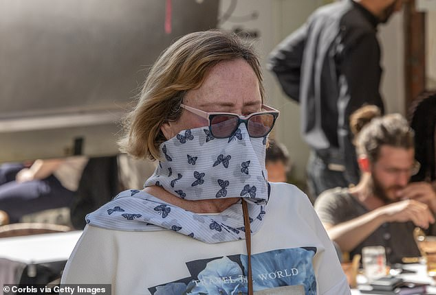 People around the world have been using scarves as makeshift masks (like this woman in Lisbon) because they can't get access to them