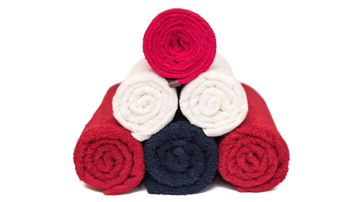 ON A ROLL: A handy trick for packing your clothes to avoid wrinkles en masse.