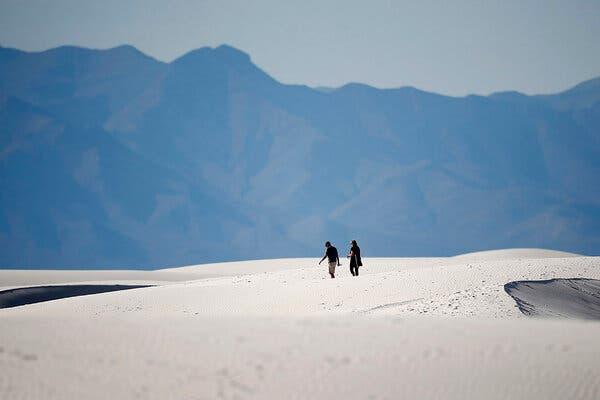 Hikers traversed a dune in the White Sands National Park in New Mexico this year.