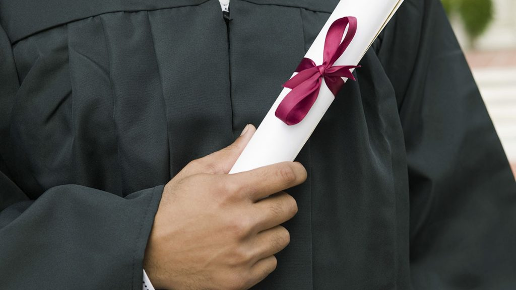 Student Holding Diploma theGrio.com
