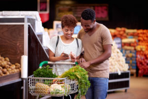 young African American couple buying groceries